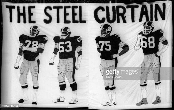 'The Steel Curtain' defense of the Pittsburgh Steelers is memorialized by an artist on a bed sheet during the AFC playoff game between the Buffalo...