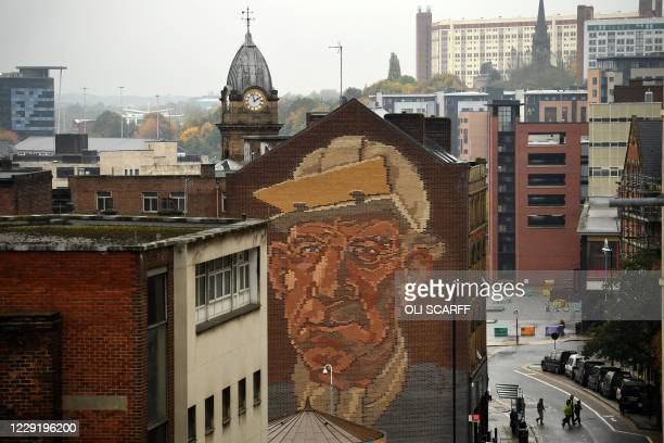 "The ""Steelworker"" Brick Mural by Paul Waplington, representing the past industrial boom, is pictured in central Sheffield, south Yorkshire on October..."