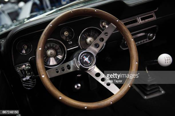 The steering wheel of a 1968 Ford Mustang 302 Convertible on display at the Royal Horticultural Halls on April 11 2017 in London England Coys...