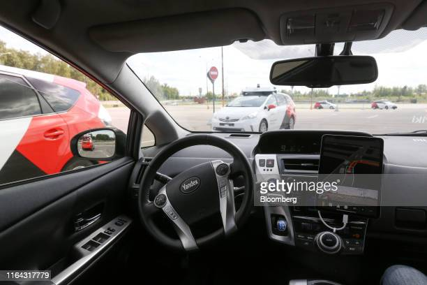 The steering wheel of a Toyota Motor Corp Prius hybrid car operated by YandexTaxi part of YandexNV turns to maneuver the vehicle in response to...