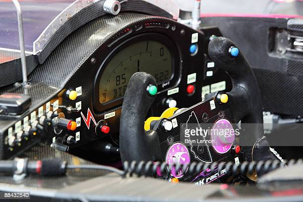 The steering wheel of the Oak Racing Pescarolo Mazda is seen during qualifying for the 77th running of the Le Mans 24 Hour race at the Circuit des 24...
