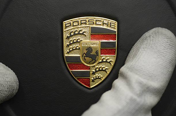 The Steering Wheel With The Porsche Logo Is Mounted In A Porsche 911