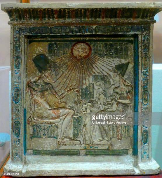 The Stela of Akhenaten and his family Egyptian Museum in Cairo Depicts the Pharaoh Akhenaten queen Nefertiti and their three children The limestone...
