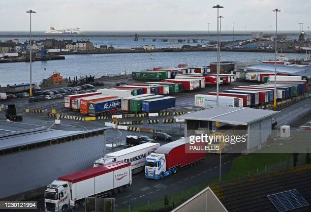 The Stena Adventurer roll-on roll-off car ferry arrives from Dublin, as a freight lorry passes through the port in Holyhead, north-west Wales on...