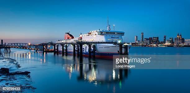 The MS Stena Mersey ferry ship berthed at Birkenhead Docks with the Liverpool skyline behind, Birkenhead, England.