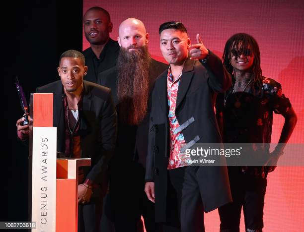 The Stereotypes accept an award from Swae Lee onstage during Spotify's Secret Genius Awards hosted by NEYO at The Theatre at Ace Hotel on November 16...