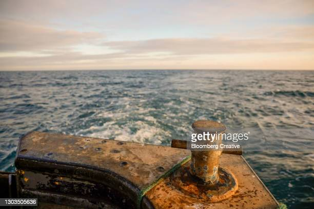the stern of a fishing trawler - weathered stock pictures, royalty-free photos & images