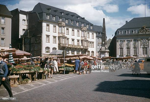 The Sternhotel in the Markt or marketplace in Bonn Germany with the Marktfontaine or Marktbrunnen in the background and the Old City Hall on the...
