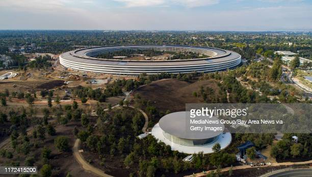 The Steve Jobs Theater foreground in the Apple Park campus is readied for Apple's next special event in Cupertino California on Thursday September 7...