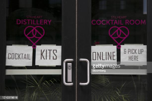 The Stilheart Distillery displays signs offering take-out cocktail kits in the North Loop neighborhood of Minneapolis, Minnesota, U.S., on Saturday,...