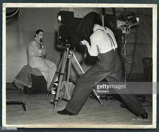 The still photographer on the set of RKO Radio's New faces of 1937 does some informal portraits of Joe Penner between scenes Penner with Harriet...