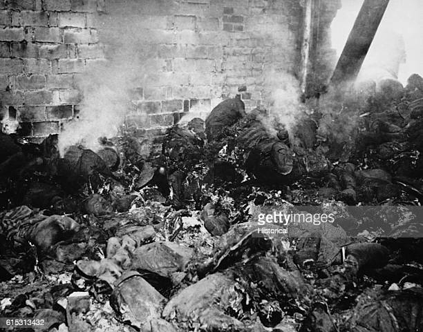 The still smoldering bodies of victims driven into a gasolinesoaked barn and incinerated by retreating SS