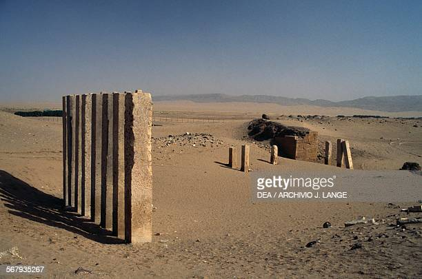 The still standing pillars of the Awwam or Haram Bilqis temple dedicated to the Moon god Almaqah Ma'rib the capital of the kingdom of Sheba Yemen...