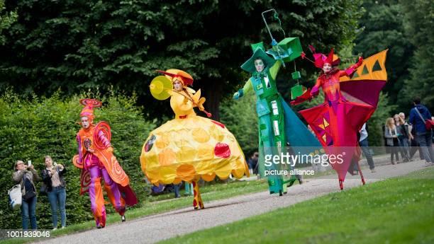 UHR The stilt walkers of Art Tremondo walk during a preview of the Cabaret Festival 'Kleines Fest im Grossen Garten' at the Herrenhausen Gardens...