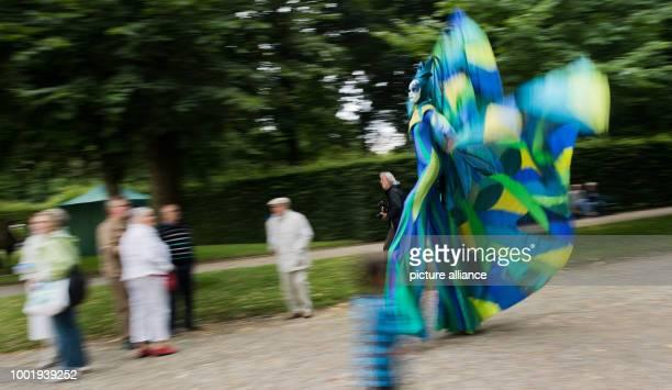 UHR The stilt walkers of Teatro Pavana walk during a preview of the Cabaret Festival 'Kleines Fest im Grossen Garten' at the Herrenhausen Gardens...