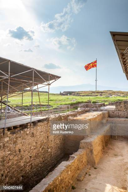 The Stobi archaeological site with a tall flag mast holding Macedonian national flag