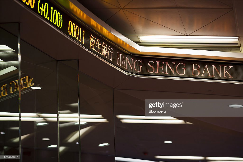 The stock code for Hang Seng Bank Ltd. is displayed on an electronic ticker on the trading floor of the Hong Kong Stock Exchange in Hong Kong, China, on Tuesday, Aug. 13, 2013. Hong Kong Exchanges & Clearing Ltd., operator of the Hong Kong Stock Exchange, is scheduled to release second-quarter results tomorrow. Photographer: Jerome Favre/Bloomberg via Getty Images