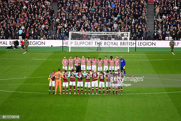 The Stoke City and West Ham United teams take part in a minute of silence in honour of Remembrance Day during the Premier League match between West...
