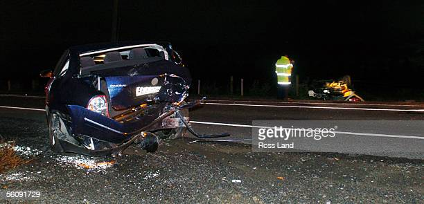 The stolen car which collided with late model VW Passat in Takanini South Auckland Tuesday night April 06 2004 lies upside down on after the...