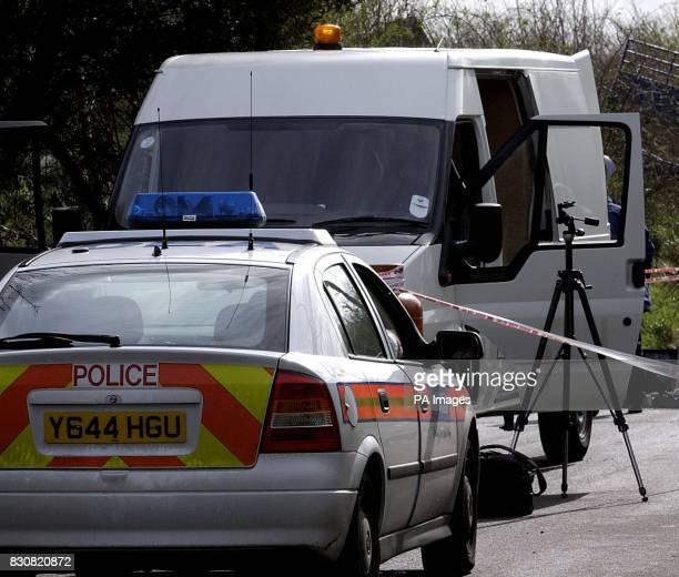 The stolen cash van used during the robbery at Heathrow Airport is checked by forensic officers at Church Road Cranford where it was left by the...