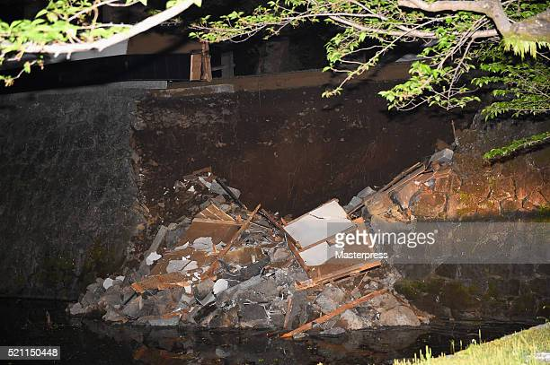 The stone wall of the Kumamoto Castle is seen partly collapsed on April 14 2016 in Kumamoto Japan A powerful earthquake with a preliminary magnitude...