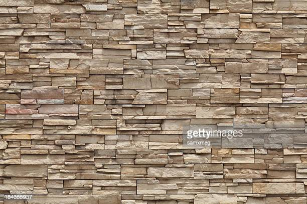 the stone wall would be great for the outside of a house - stone material stock photos and pictures
