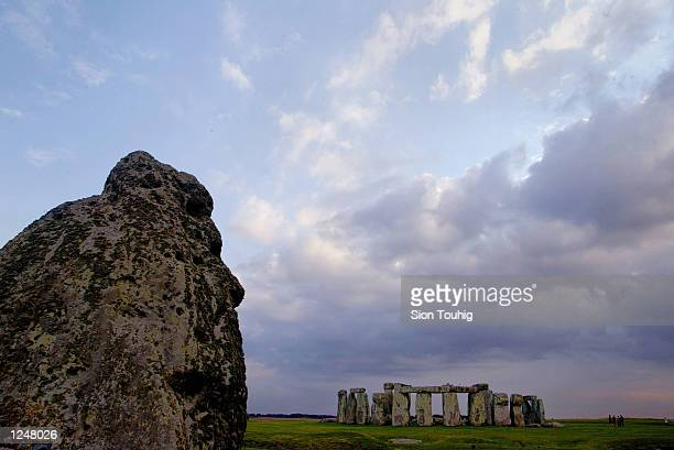 The Stonehenge Ancient Monument is seen behind an outer stone marker August 3, 2002 near Amesbury in Wiltshire, United Kingdom. The monument, a range...