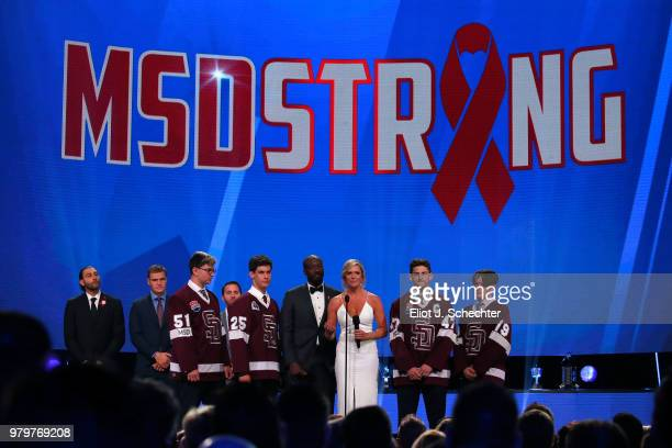 The Stoneman Douglas High School hockey team NHL Network sportscasters Anson Carter and Kathryn Tappen speak onstage prior to announcing the winner...
