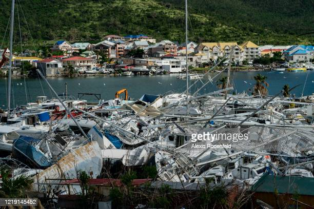 The storm caused catastrophic damage as here where boats are found either beached on land or sunken at the bottom of the sea on November 06...