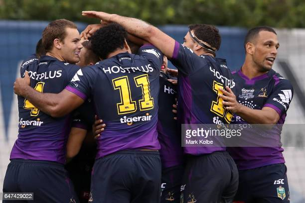The Storm celebrate with Suliasi Vunivalu of the Storm after he scored a try during the round one NRL match between the Canterbury Bulldogs and the...