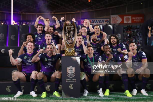 The Storm celebrate with the Provan-Summons Trophy after winning the 2017 NRL Grand Final match between the Melbourne Storm and the North Queensland...