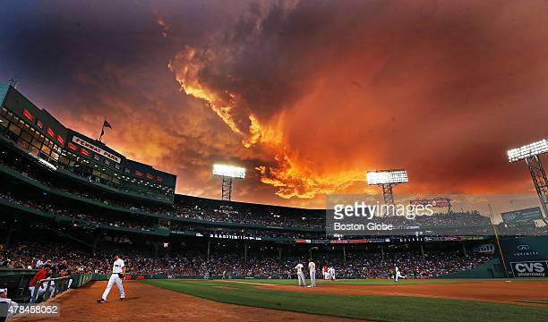 The storm clouds in the area provided a colorful and appropriate backdrop as Red Sox starting pitcher Joe Kelly bottom left exits the game after...