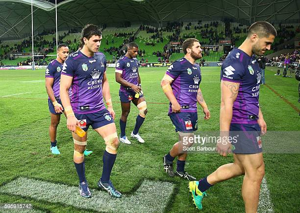 The Storm leave the field after losing the round 25 NRL match between the Melbourne Storm and the Brisbane Broncos at AAMI Park on August 26 2016 in...