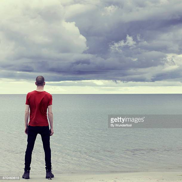 the storm - red shirt stock pictures, royalty-free photos & images