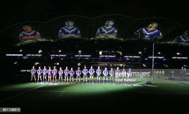 The Storm stand for a minutes silence during the round eight Anzac Day NRL match between the Melbourne Storm and New Zealand Warriors at AAMI Park on...