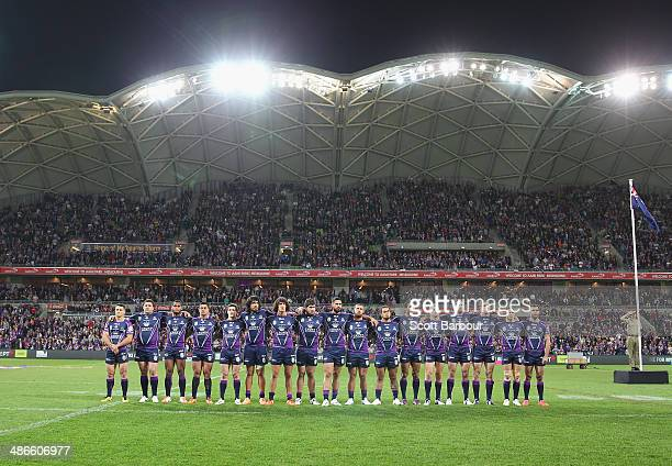 The Storm stand for the national anthems during the round 8 NRL match between the Melbourne Storm and the New Zealand Warriors at AAMI Park on April...
