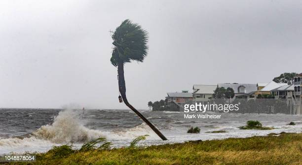 The storm surge and waves from Hurricane Michael batter the beachfront homes on October 10 2018 in the Florida Panhandle community of Shell Point...