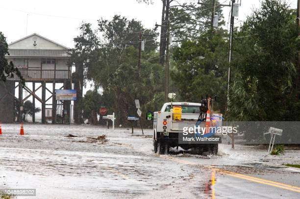 The storm surge and waves from Hurricane Michael start to overtake the roads and homes four hours prior to high tide on October 10 2018 in the...