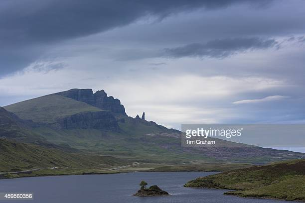 The Storr escarpment and The Old Man of Storr rock pinnacle in Trotternish Ridge with Loch Fada on the Isle of Skye in the Highlands and Islands of...