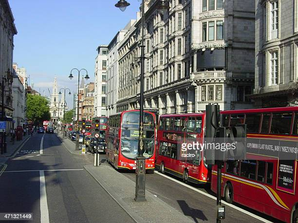The Strand London filled with oncoming double decker busses