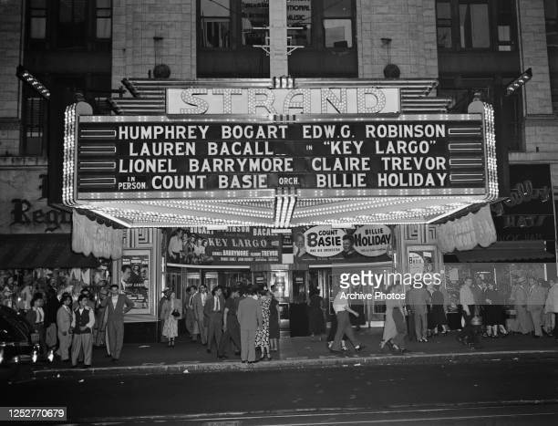 The Strand Theatre in Manhattan, New York City, advertising the film 'Key Largo' and an appearance by Count Basie and his orchestra, and singer...