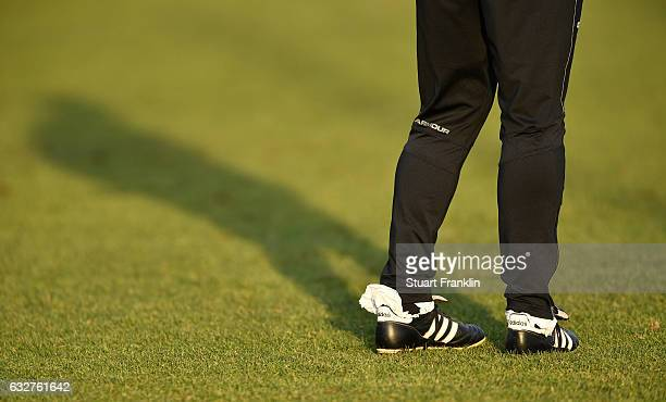 The strange padding in the boots of Ewald Lienen head coach of St Pauli during a training session of FC St Pauli on January 26 2017 in Hamburg Germany