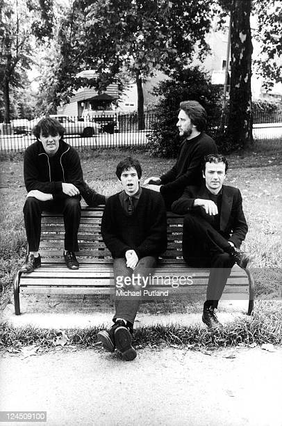 The Stranglers group portrait Primrose Hill London August 1980 Dave Greenfield JeanJacques Burnel Jet Black Hugh Cornwell