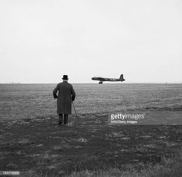 The Strategic Air Offensive Against Germany 19391945 Prime Minister Winston Churchill watches a Short Stirling heavy bomber of No 7 Squadron Royal...
