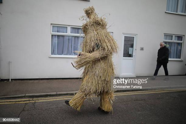 The Straw Bear dances through the streets during the annual Whittlesey Straw Bear Festival parade on January 13, 2018 in Whittlesey, United Kingdom....