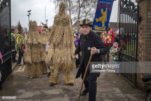 The Straw Bear dances through the streets during the annual Whittlesey Straw Bear Festival parade on January 13 2018 in Whittlesey United Kingdom The...