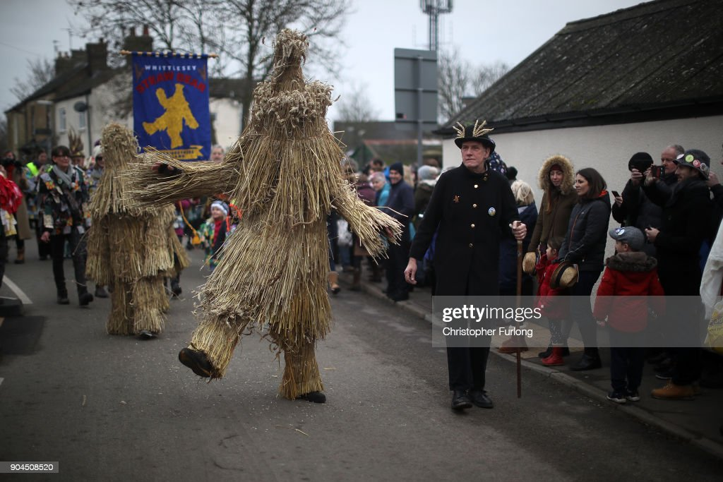 The Straw Bear dances through the streets during the annual Whittlesey Straw Bear Festival parade on January 13, 2018 in Whittlesey, United Kingdom. The traditional event was revived in 1980 and features a 'Straw Bear' and it's children being led through the streets of the English village of Whittlesey, near Peterborough, United Kingdom. The bear dances, while musicians break off into groups around the village square to perform with many different Morris, Molly, Sword, Mummer and Appalachian dancing teams.