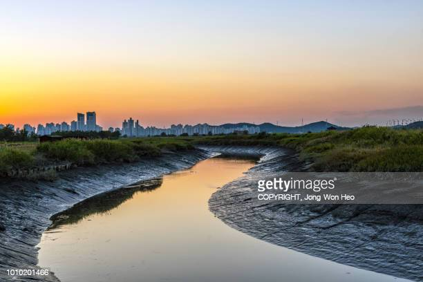 The stream of sea water to the town in the sunset