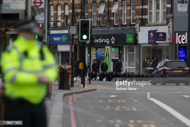 The Streatham High Road remains closed as police officers perform a fingertip search on the crime scene 24hrs after the terrorist attack in south...