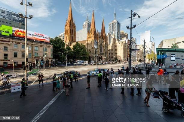 The street outside Flinders Street station is cordoned off by Australian police at the scene where a car ran over pedestrians in downtown Melbourne...